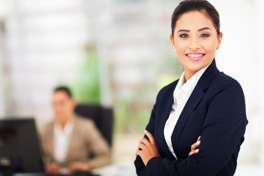 portait of smilling business woman in office